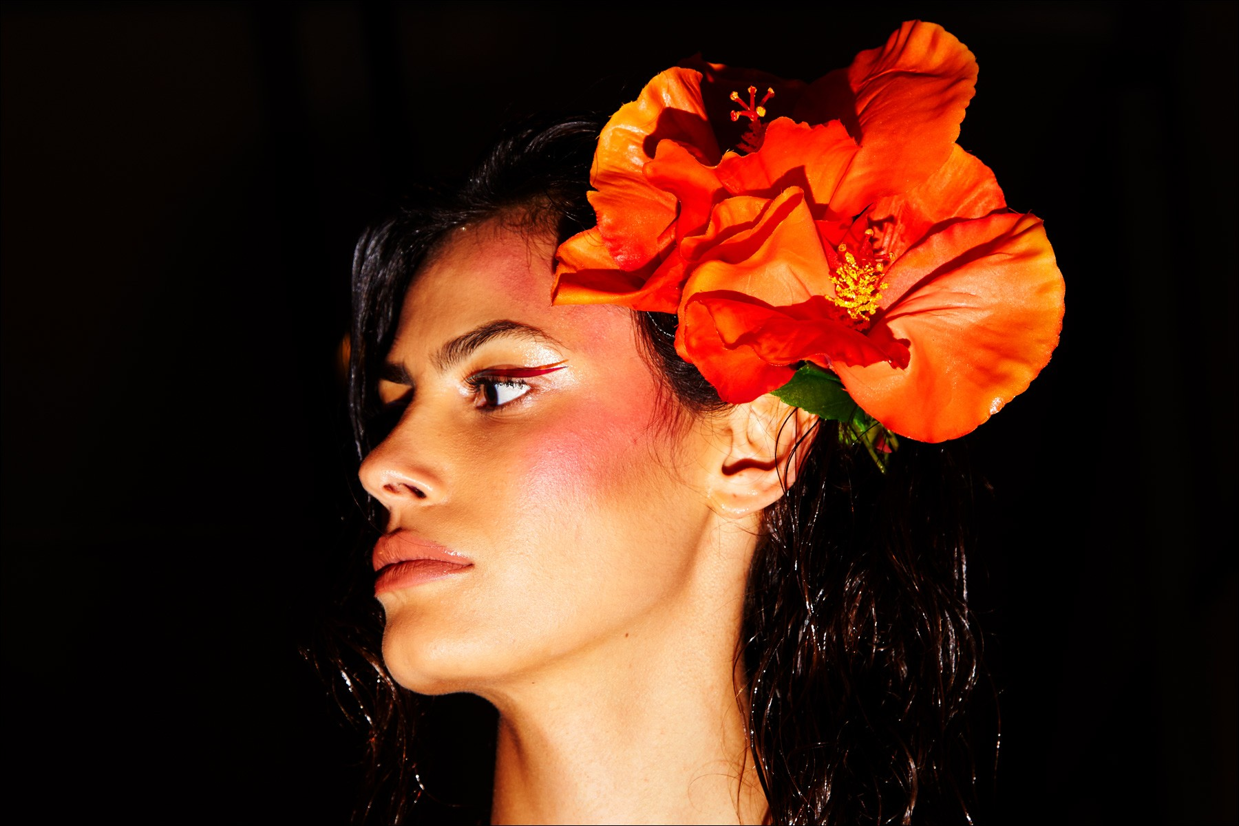 Model with orange flower, backstage at The Blonds for Spring/Summer 2018. Photographed by Alexander Thompson for Ponyboy magazine NY.