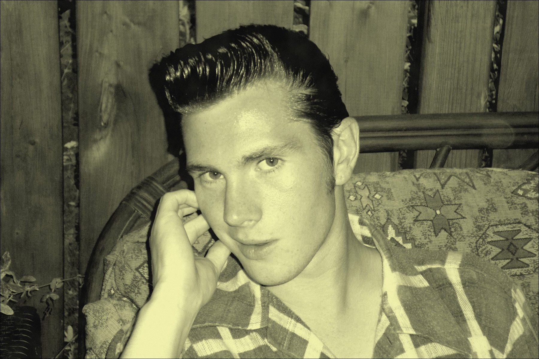 A B&W portrait of rockabilly performer Lew Phillips. Ponyboy magazine NY.