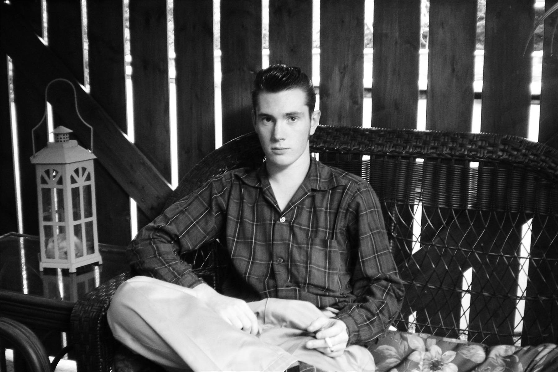 B&W portrait of rockabilly performer Lew Phillips. Ponyboy magazine New York.