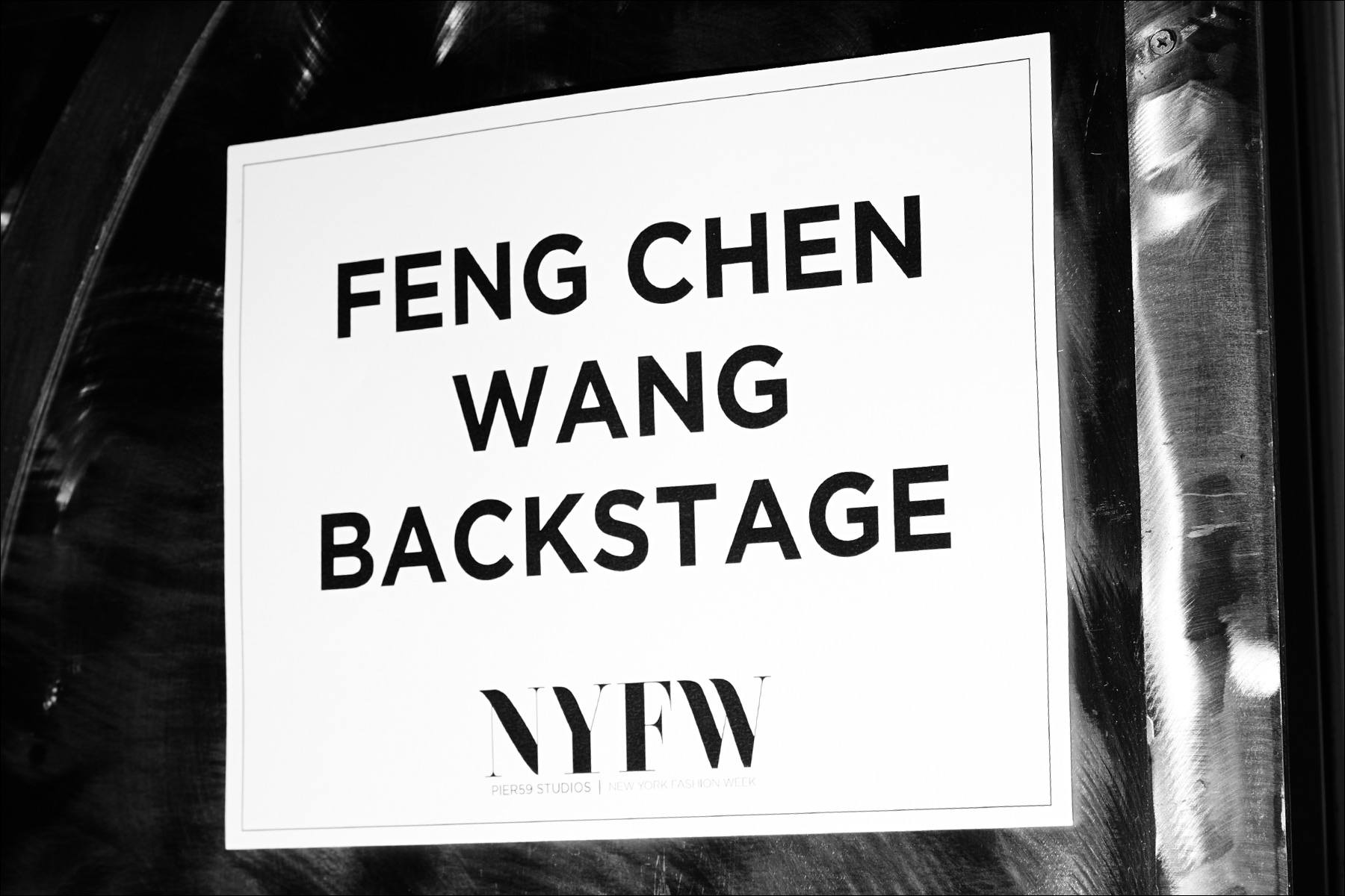 Backstage sign for designer Feng Chen Wang. Photography by Alexander Thompson for Ponyboy magazine.