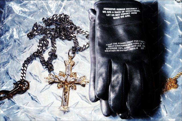 A crucifix and black leather gloves backstage at the Willy Chavarria menswear show. Photography by Alexander Thompson for Ponyboy magazine.