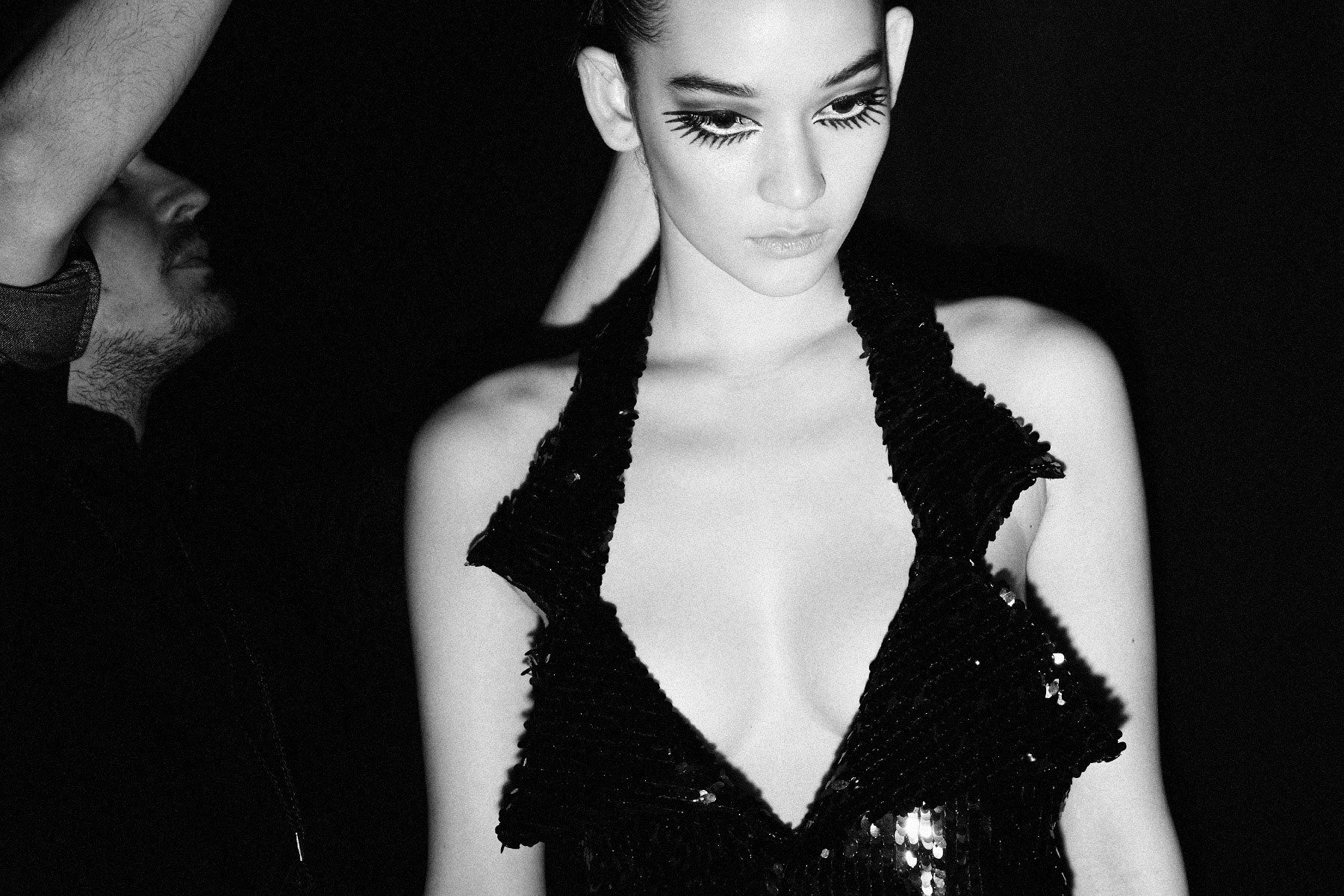 Spiky lashes with a halter sequin dress backstage at Christian Cowan for Fall 2018. Photographed by Alexander Thompson for Ponyboy magazine.