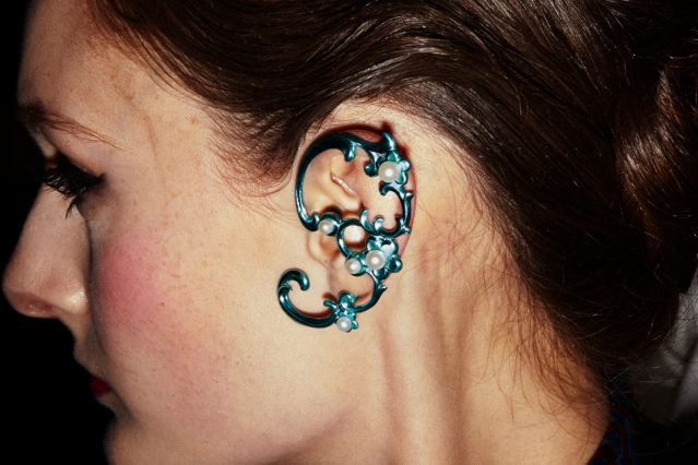 An elaborate earring clip backstage at Snow Xue Gao F/W18 collection during New York Fashion Week. Photographed for Ponyboy magazine by Alexander Thompson.