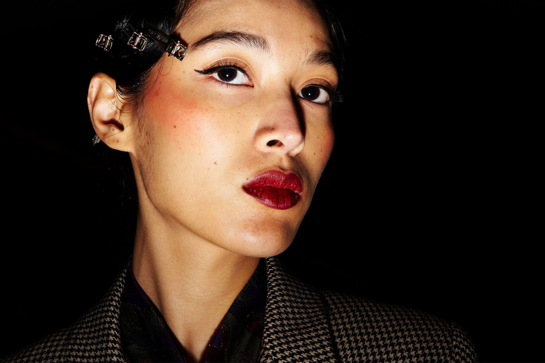 Close-up shot of a model backstage at Snow Xue Gao Fall/Winter 2018. Photographed by Alexander Thompson for Ponyboy magazine.