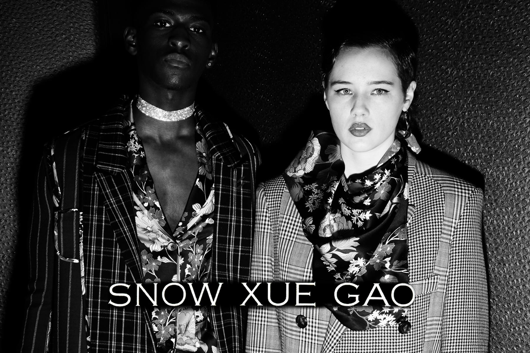 A male and female model pose backstage at Snow Xue Gao Fall/Winter 2018. Photographed by Alexander Thompson for Ponyboy magazine.