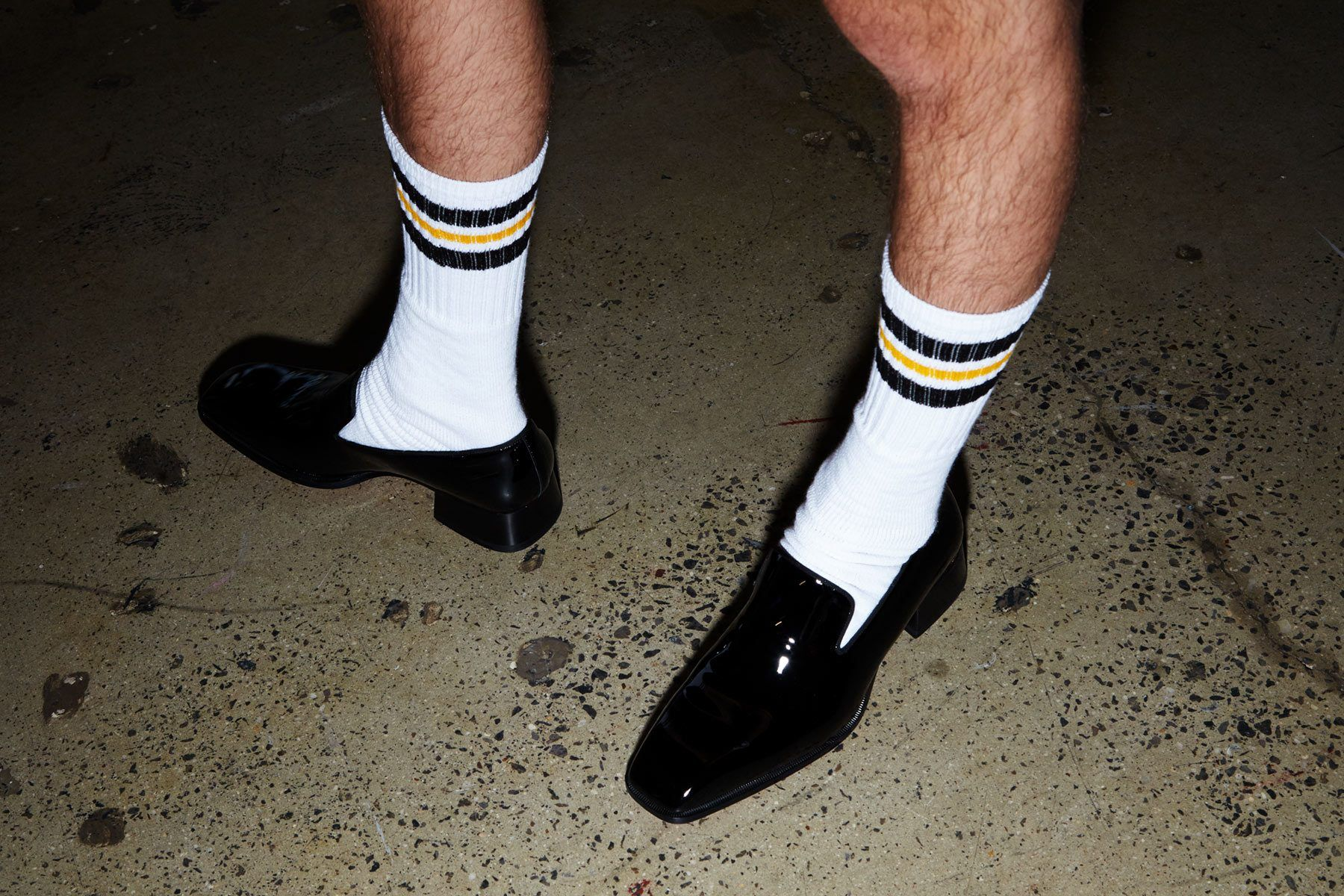 Tube socks and Christian Louboutin dress shoes backstage at David Hart for Spring/Summer 2019. Photography by Alexander Thompson for Ponyboy magazine.