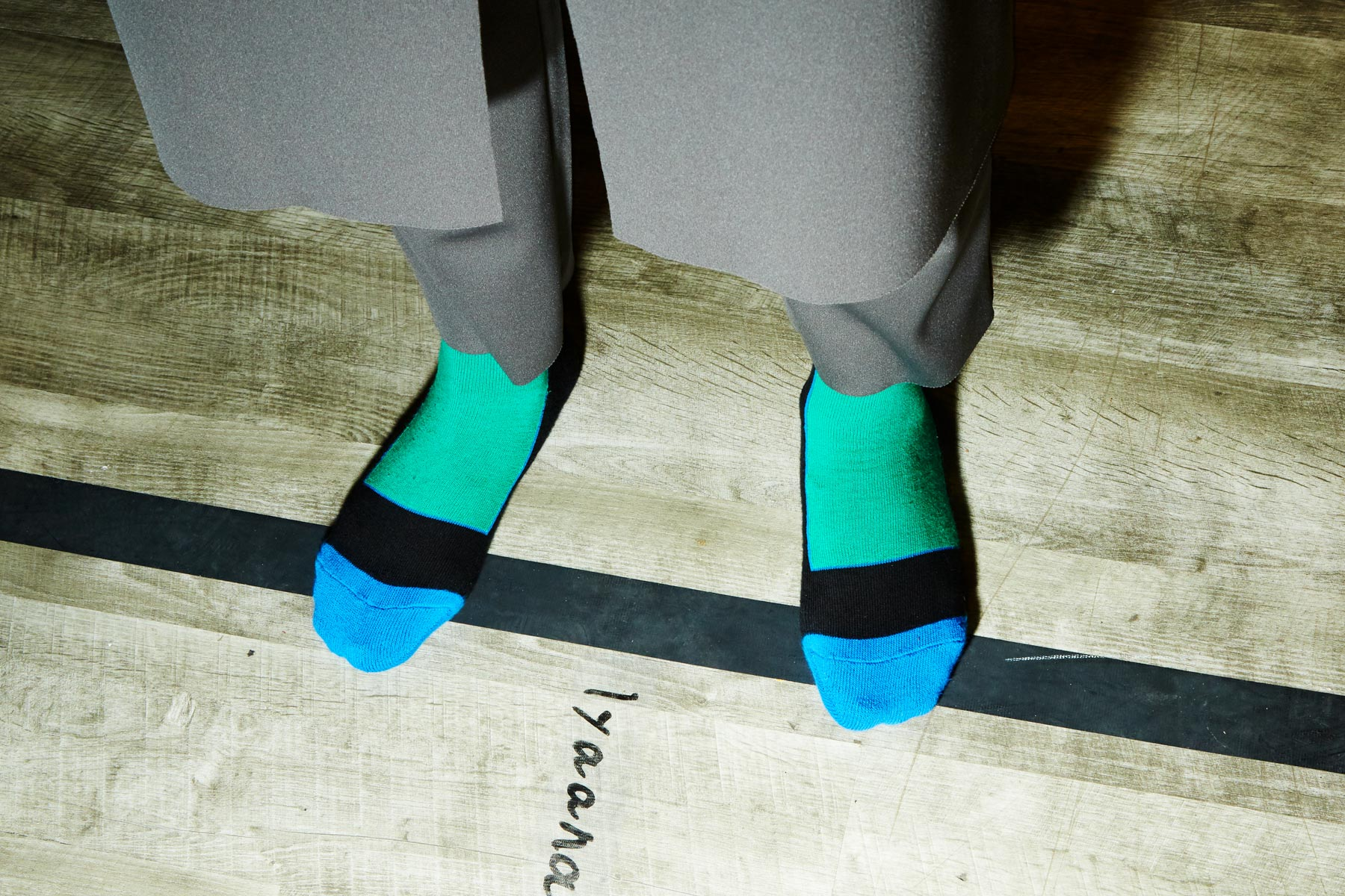 Color blocked men's socks backstage at N. Hoolywood Spring 2019 show. Photography by Alexander Thompson for Ponyboy magazine.