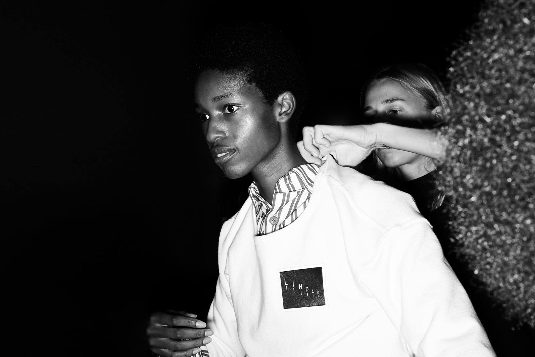 A model gets dressed backstage at the Linder Spring/Summer 2019 collection, photographed by Alexander Thompson for Ponyboy magazine.