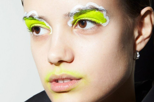 A model's day-glo makeup snapped backstage at the Laurence & Chico F/W 2019 collection. Photographed by Alexander Thompson for Ponyboy magazine.