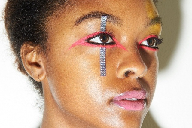 A model's colorful makeup snapped backstage at the Laurence & Chico F/W 2019 collection. Photographed by Alexander Thompson for Ponyboy magazine.