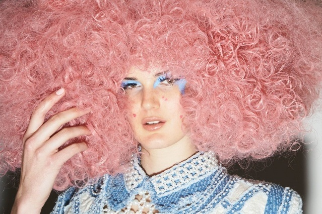 A model photographed backstage in an outrageous wig at the Laurence & Chico fashion show for Fall/Winter 2019. Photography by Alexander Thompson for Ponyboy magazine.