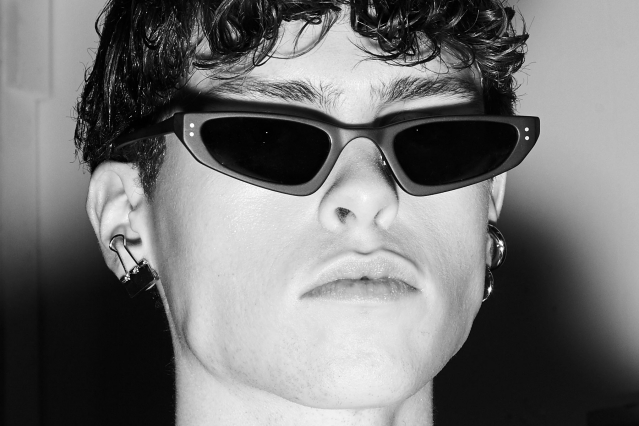 A male model snapped in sunglasses backstage at Peacebird A/W 2019 by Alexander Thompson for Ponyboy magazine.