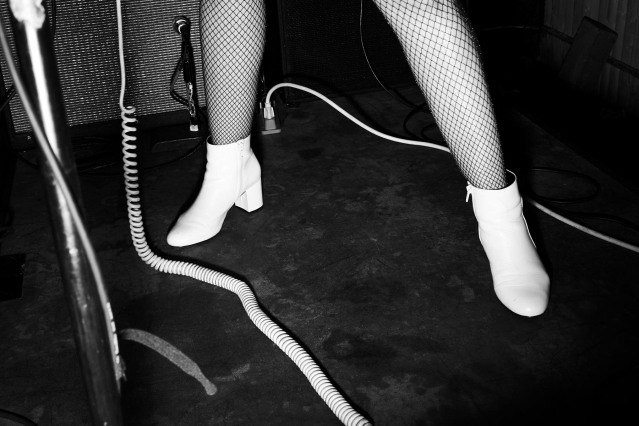 White boots photographed at a Babyshakes show in New York City. Photography by Alexander Thompson for Ponyboy magazine.