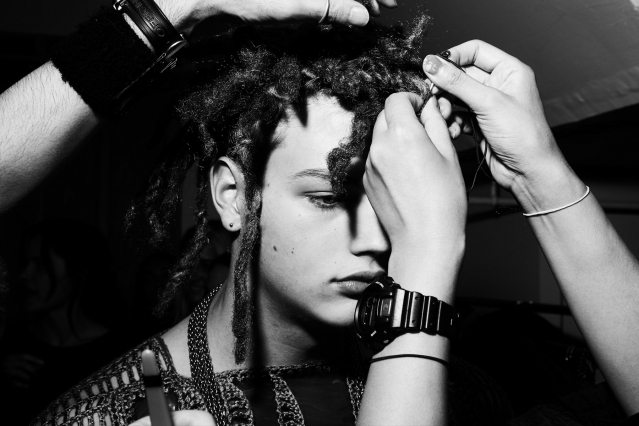 A male model snapped backstage in hair at Fix & Fax by Katya Leonovich. Spring 2020. Photography by Alexander Thompson for Ponyboy magazine.