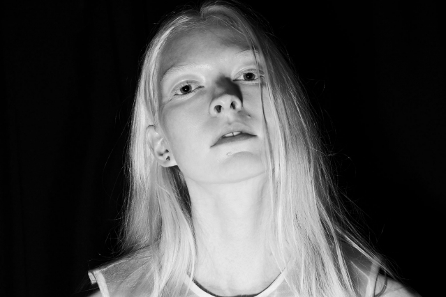 A b&w image of a model backstage at threeASFOUR S/S2020. Photography by Alexander Thompson for Ponyboy magazine.