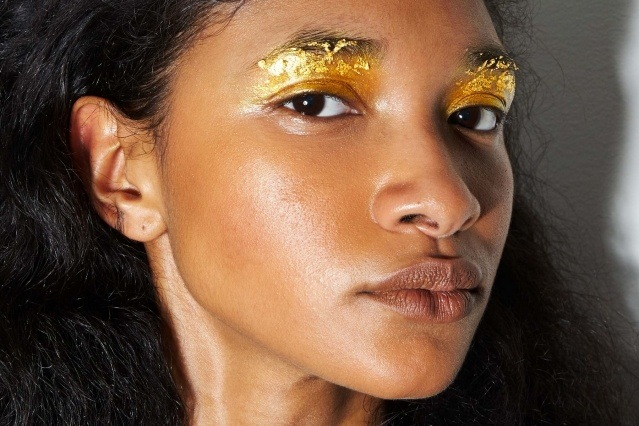 Gold eyeshadow photographed on model Aleya, backstage at Dirty Pineapple for F/W 2020. Photography by Alexander Thompson for Ponyboy magazine.