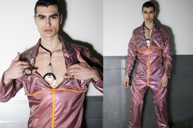 A male model photographed backstage in a metallic jumpsuit at the Fix & Fax show for Fall 2020 at Pier 59 Studios. Photography by Alexander Thompson for Ponyboy magazine.