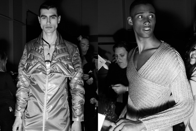 Male models photographed in a jumpsuit & knitwear backstage at the Fix & Fax show for Fall 2020 at Pier 59 Studios. Photography by Alexander Thompson for Ponyboy magazine.