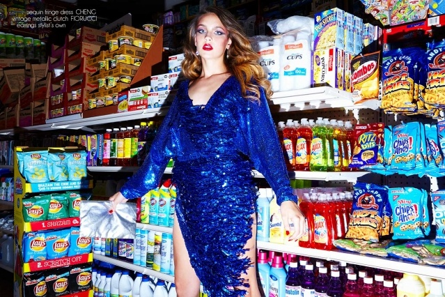 Izzy Pawline wears a sequined blue dress by Cheng, for Ponyboy magazine. Photographed by Alexander Thompson.