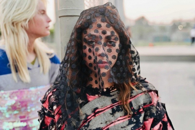 A model photographed at the 2021 Imitation Of Christ show. Ponyboy magazine.